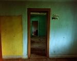 Steve Fitch: Hallway view through a house in Ocate, eastern New Mexico, August 31, 1991